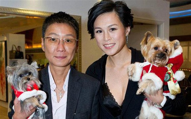 Bounty: Gigi Chao (right) is believed to have married her girlfriend of seven years Sean Eav (left) in France, yet her businessman father has offered £40million to the man that can woo his daughter