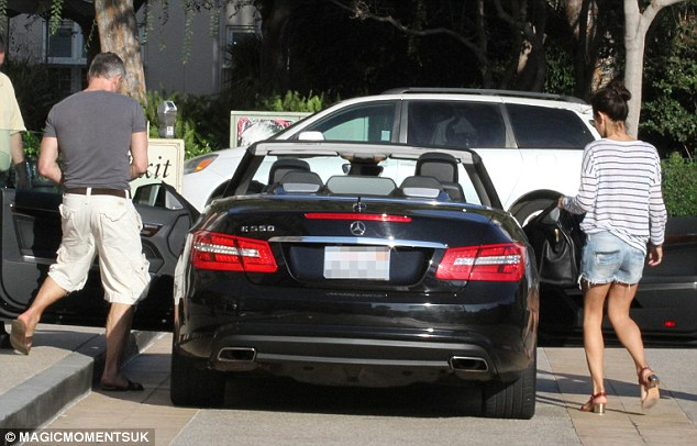 Cool couple: Gary and Danielle were seen getting into a black Mercedes convertible