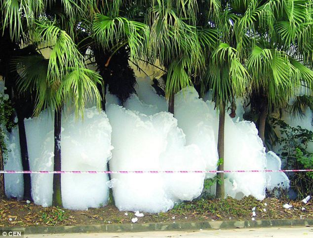 Wall of foam: The suds are thought to have been caused by a chemical spillage in Xintang in China's Guangdong province