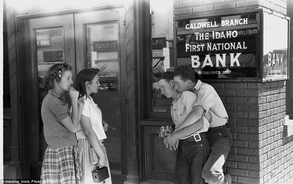 Sock hop: Two seemingly gay couples from the 1950s pass the time outside a bank in Idaho