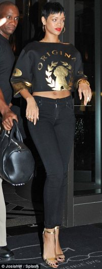 Taut tummy: Rihanna flashed her midriff as she grabbed some dinner at Emilio Ballato's restuarant