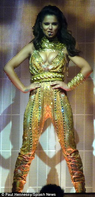 Golden girl: Cheryl looked incredible in a brash shining jumpsuit designed by stylist Renelou Padora
