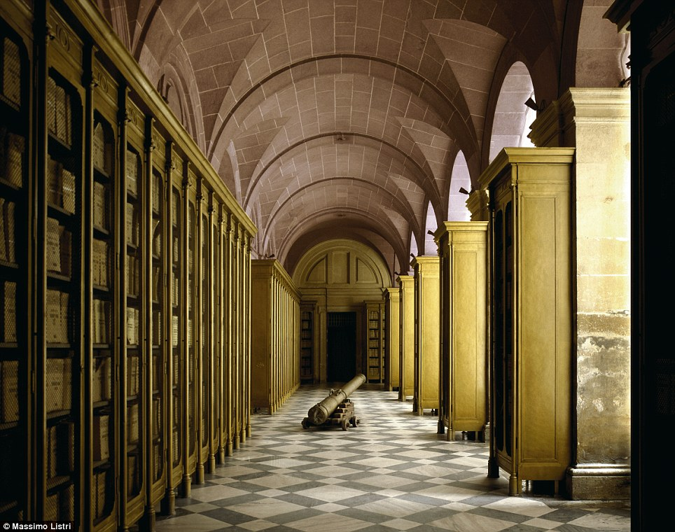 Trade paths: The General Archive of the Indies, in Seville, Spain, was built in the 1570s; a lone cannon lays on the floor of the arched library