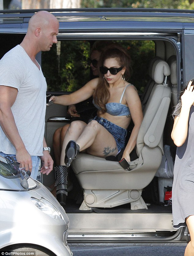 Born this way: Gaga even needed help getting out of the car as she kept her legs on show in the shorts