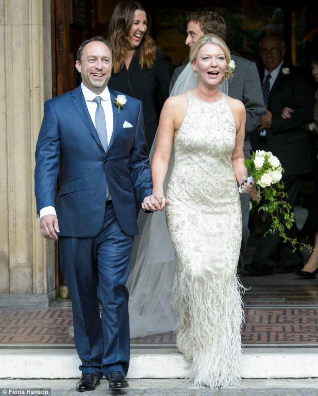 Happy couple: Wikipedia founder Jimmy Wales and Tony Blair's former diary Secretary Kate Garvey tie the knot
