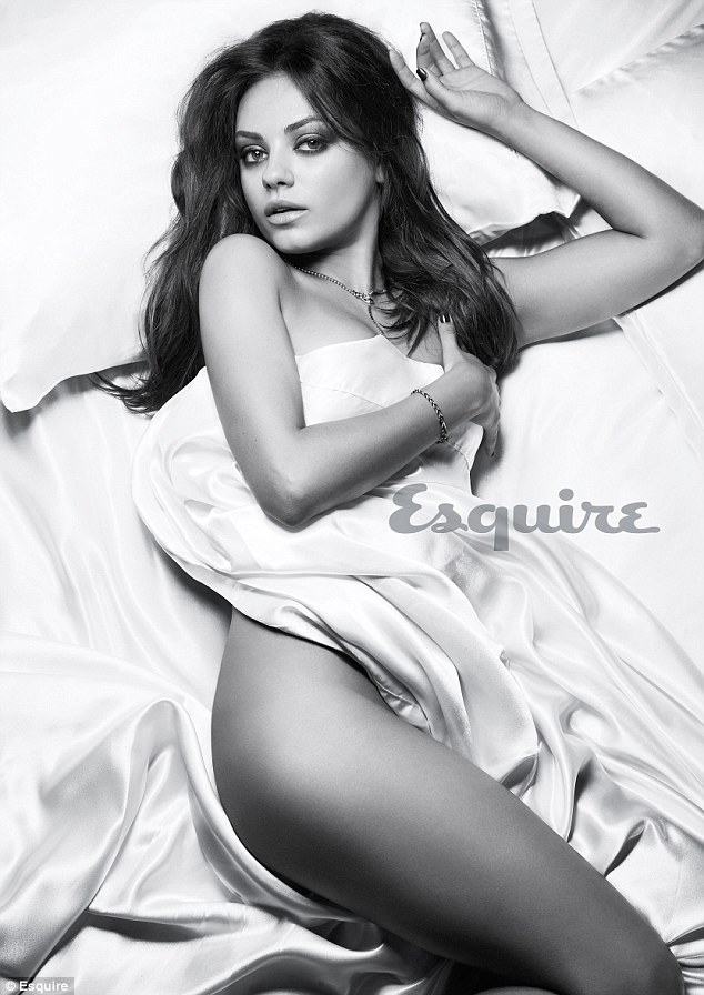 Provocative: The star seems to be wearing not underwear as she writhes around on a bed for the photo shoot