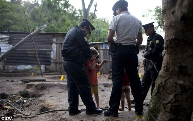 Six-year-old Carlos Daniel Gonzalez shows police how gunmen killed his parents and other family members