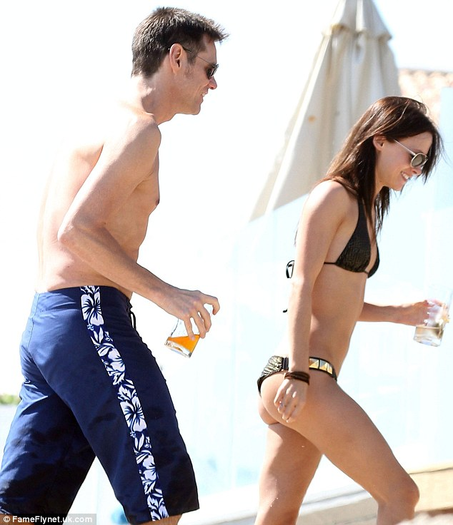 Rearly naughty: Jim was caught looking at his girlfriends derrière as he purposely walked behind her