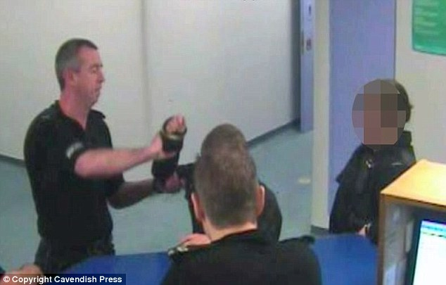 CCTV footage from the custody suite at Swinton Police station of PC Stephen Hudson gripping the teenager