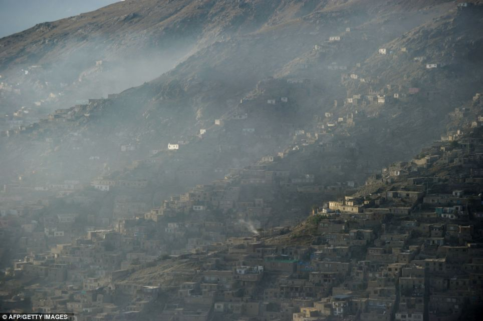 Teeming with life: The crowded hills of Kabul's outer suburbs are home to more than a million residents. Many of them are among the 23 per cent of Kabulis who live below the poverty line