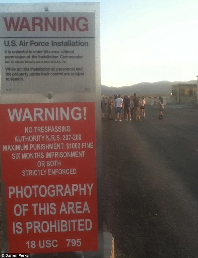 Do not enter: The moment the team sneak into Area 51 - and security teams immediately step in to arrest them