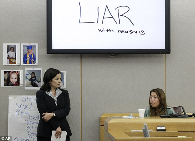 The words shown on an overhead display were written by prosecutor Eren Price, (left) and were shown in court as an emotional Elizabeth Escalona, 23, responds to a line of questioning in court yesterday