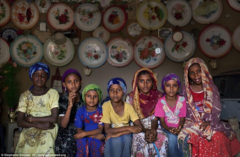 Vulnerable: Young girls sit inside a home outside of Al Hudaydah, Yemen, in 2010