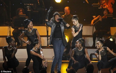 Centre of attention: Hudson rocked the mic alongside female dancers who were dressed in all black