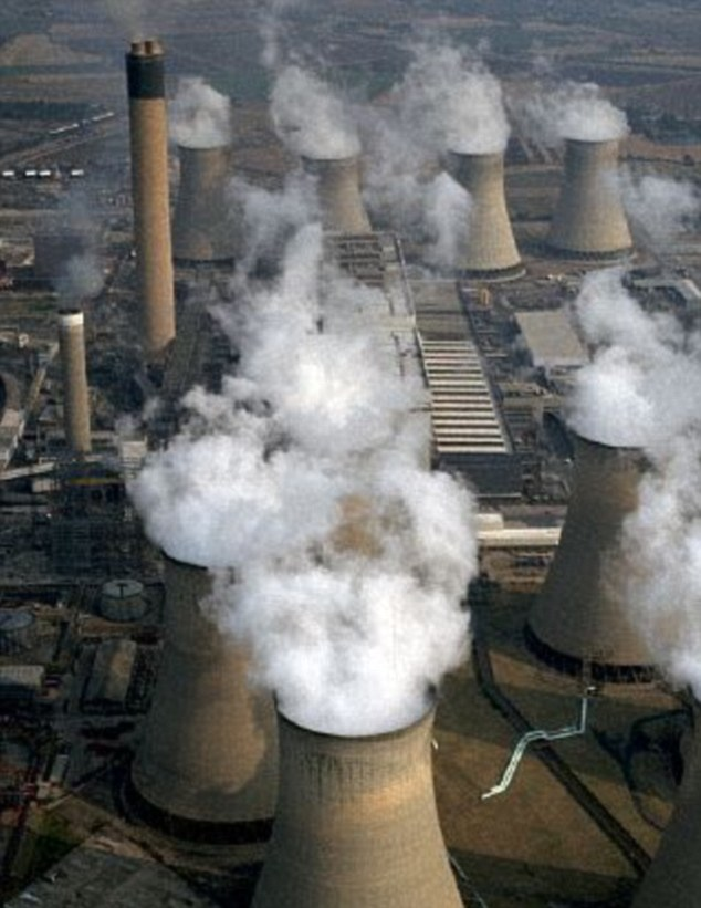 Damage: Global warming has been caused in part by the CO2 emitted by fossil fuels. This image shows smoke billowing out of a power station