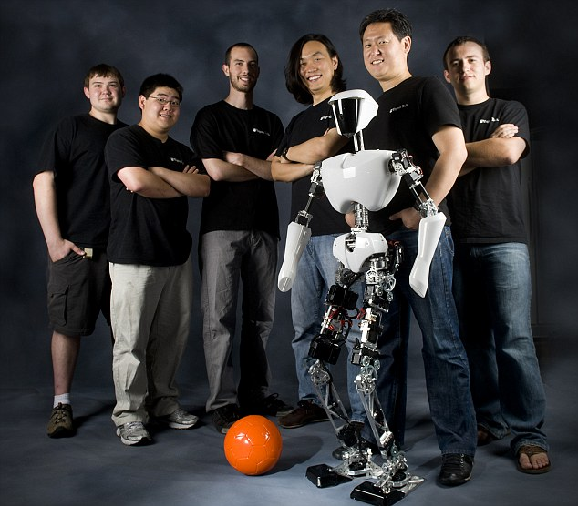 The team of engineers and scientists pose with their latest creation, Ash. They hope to test it earlier next year