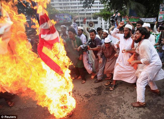 islamo fascists burn usa flags baying for blood Bangladesh: Around 10,000 Muslims from half a dozen Islamist groups staged a noisy protest in Bangladeshi capital Dhaka, burning and trampling American flags while chanting anti-US slogans on September 14