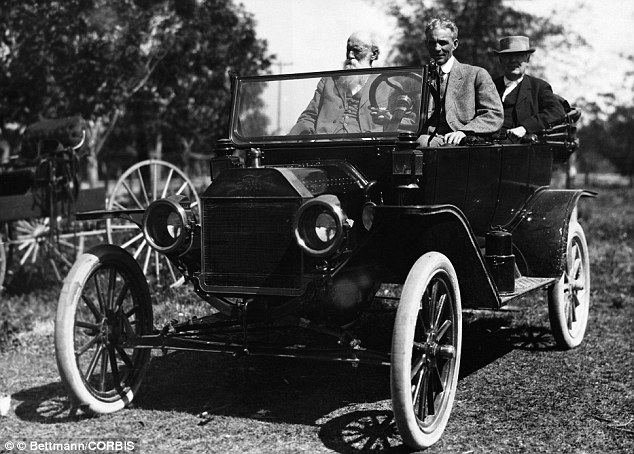 Henry Ford: Pictured with Thomas Edison in his Model T, Mr Ford accumulated a net worth equivalent to $199 billion dollars in 2012