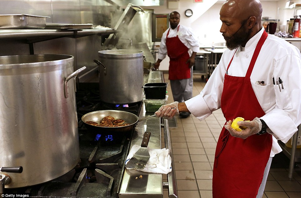 Cooks prepare meals at the Cathedral Kitchen soup kitchen which serves 300 to 600 meals a day to the needy