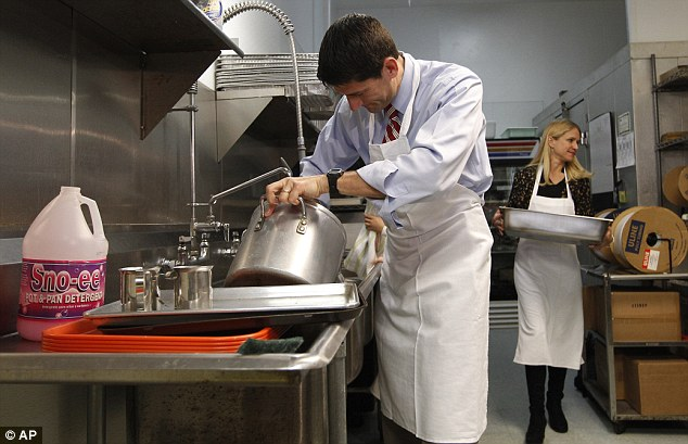 Opportunist? Vice presidential candidate Paul Ryan, and his wife Janna, are seen scrubbing already-clean pots