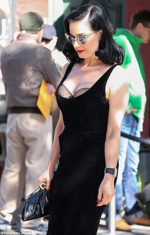 Dotty about you: Dita Von Teese flashes her bra but still manages to look sophisticated and immaculate on a stroll around New York