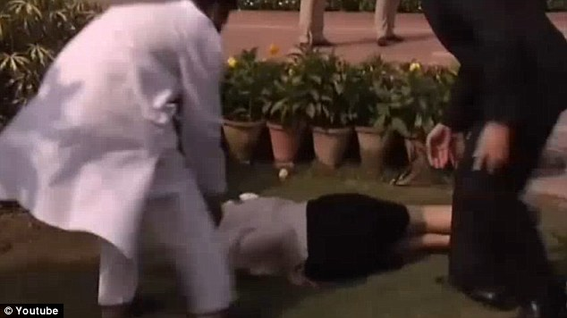 The politician lies on the ground, taken aback by her quick fall