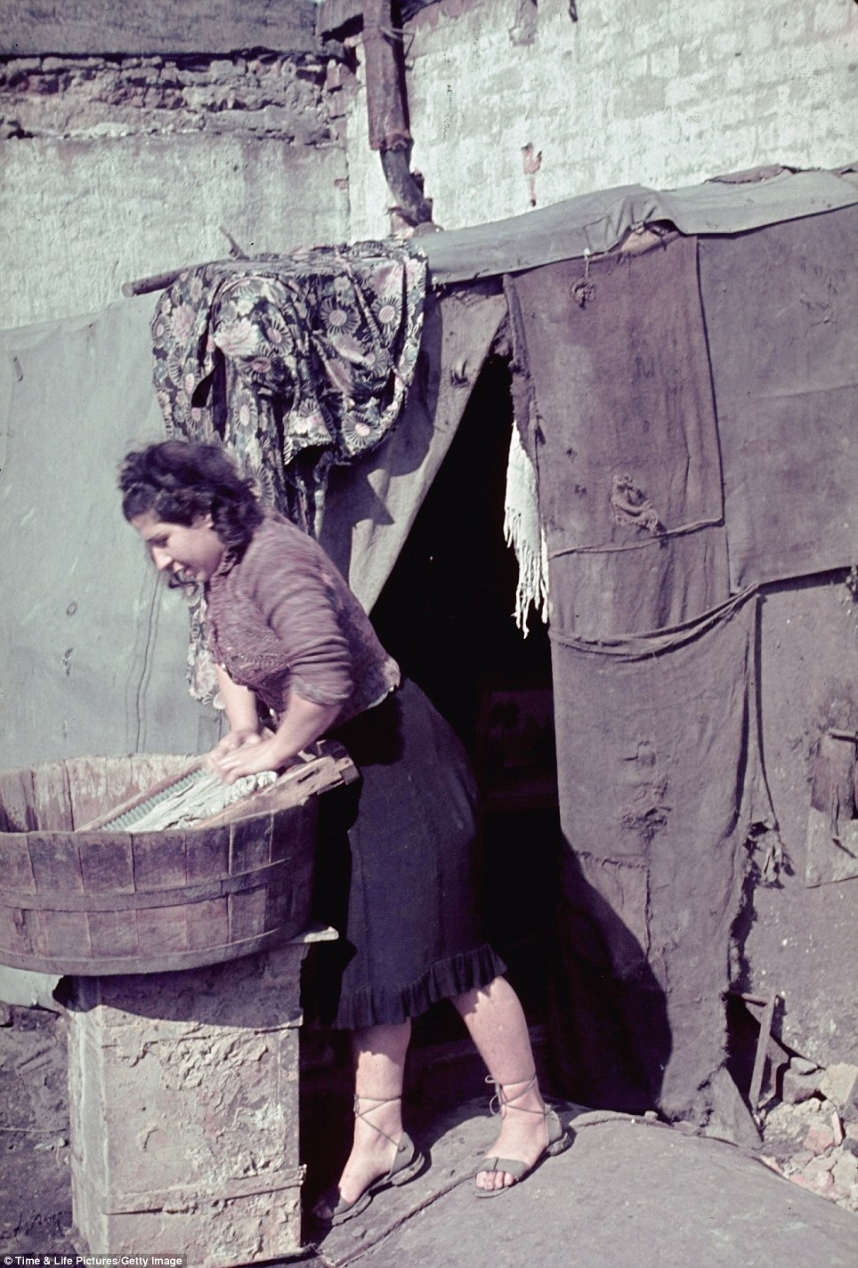 A Jewish woman uses a washing board to clean clothes in the Kutno. Unusually for an ardent Nazi, Jaeger's allowed his Jewish subjects to retain their dignity and humanity