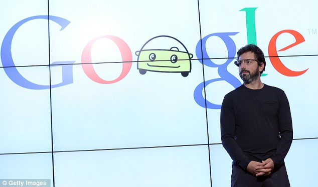 Grim news: Google is attempting to turn its fortunes around with projects such as the driverless car and the digital glasses worn here by co-founder Sergey Brin