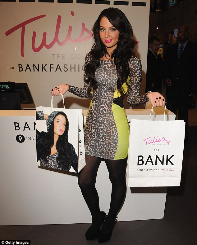 Too much Photoshop? Tulisa's features looked heavily airbrushed on the bags too