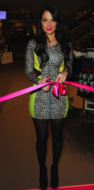 I now declare this boutique... open! Tulisa cuts the ribbon