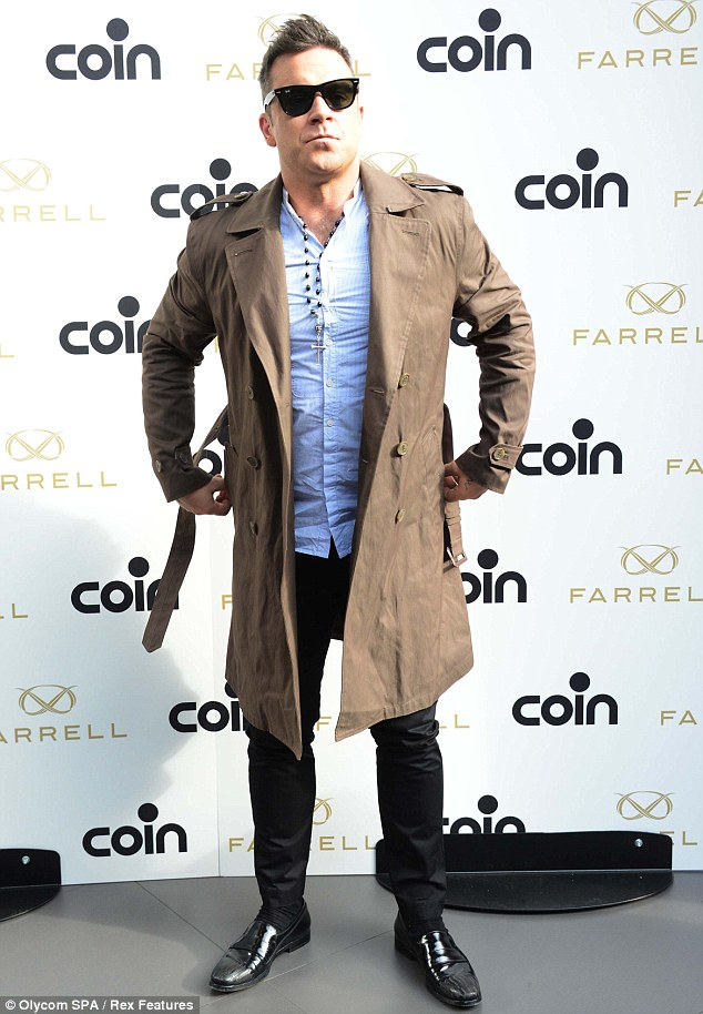 Dapper dude: Robbie was in Milan, Italy, to launch his menswear label Farrell at luxury department store Coin