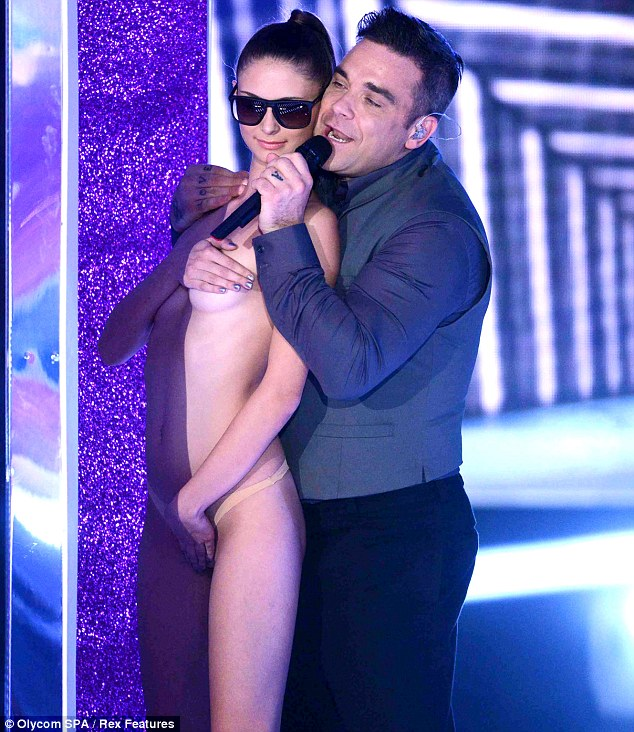 Raunchy: Robbie made sure to shock viewers with his amorous routine