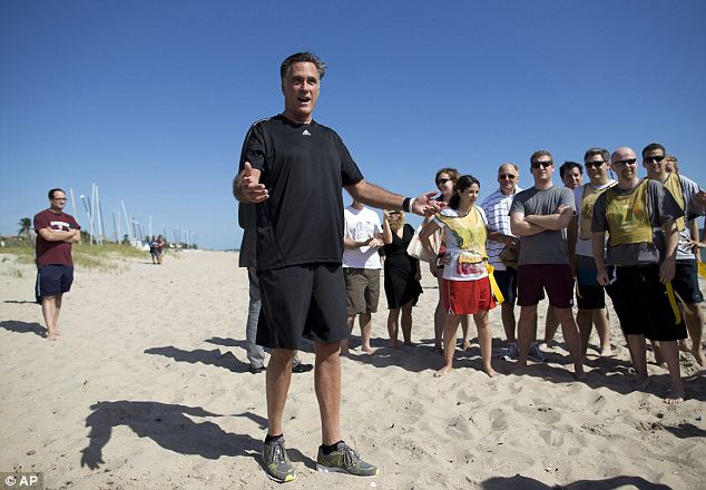 Master of ceremonies: Mitt Romney, who was at the beach separately from his wife, organized a game of flag football between the pool reporters who cover his campaign and his staffers