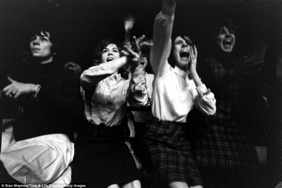 Beyond adoring: Screaming and wailing, the first Beatle fans to witness the band perform in the U.S. in 1964 are pictured