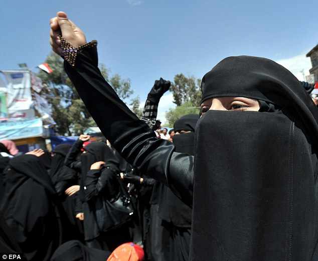 A veiled Yemeni protester campaigning within the country against the government