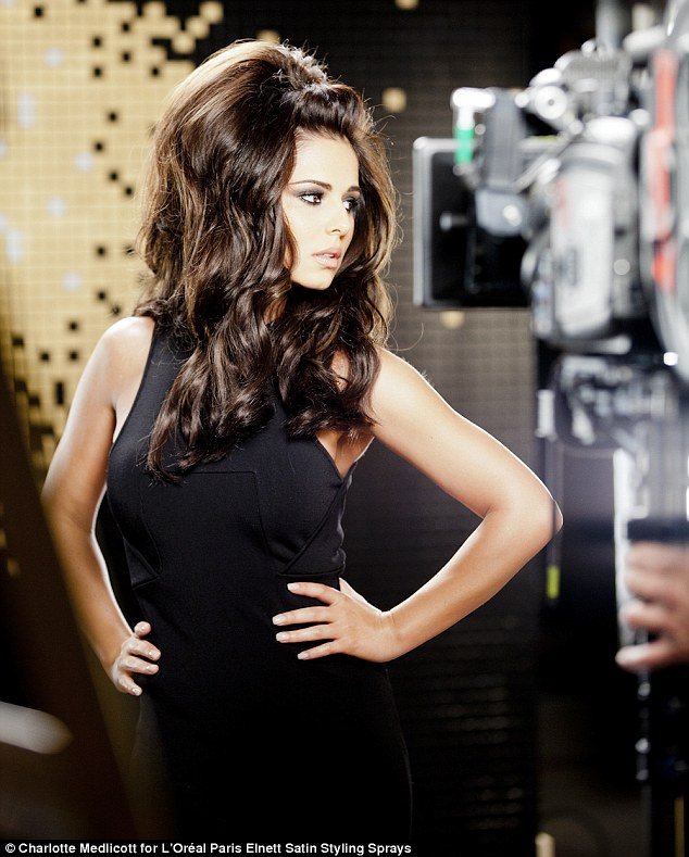 Whip it back and forth: Cheryl Cole brings back her big hairtsyle as she does a photoshoot for L'Oreal