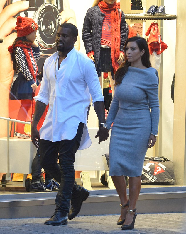 Heading to the shops: The couple visited Florence as part of Kim's continued birthday trip but were more interested in buying more clothes
