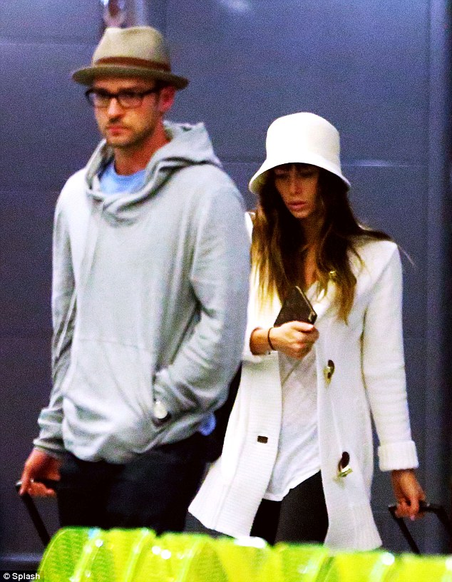 Newlyweds: Justin and Jessica were seen leaving Italy on Sunday after their nuptials