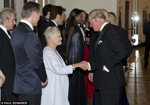 Royal company: The star rubbed shoulders with Prince Charles at the glittering event, with him no doubt complimenting her on her unusual neck accessory