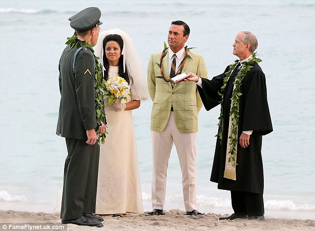 Picturesque setting: It seems by looking more closely that Jon's character Don is acting as a witness for the nuptials