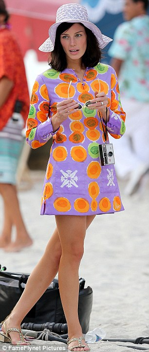 Quick change: Jessica was later seen wearing the same hat with a colourful patterned kaftan-style outfit