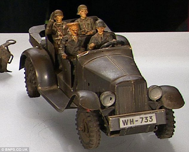 The German toy shows Adolf Hitler figure seated in the front passenger seat of an army jeep alongside three German soldiers