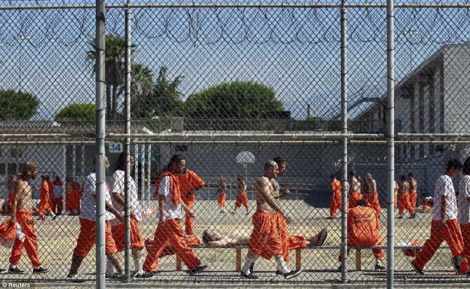 This prisoner in Chino tries to make the most of the relative open space of the exercise yard, but is still surrounded by fellow convicts