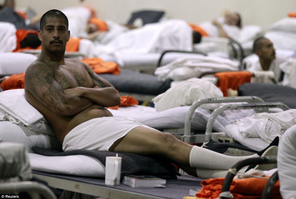 This tattooed prisoner at the California Institution for Men state prison in Chino makes the most of stretching out, but the picture shows how close together the beds are