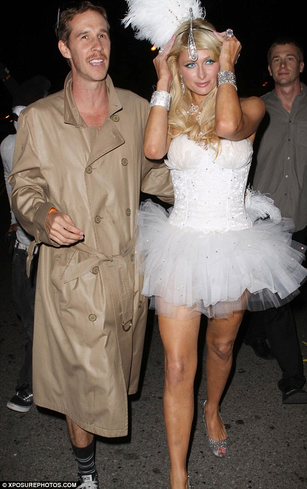Vision in white: Paris donned a white tutu on a night out for Halloween with then-boyfriend, Doug Reinhardt in October 2009