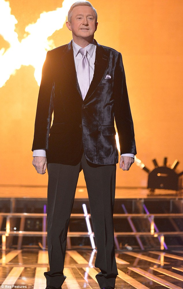 On fire: Louis looks smart as he takes to the stage at The X Factor studios