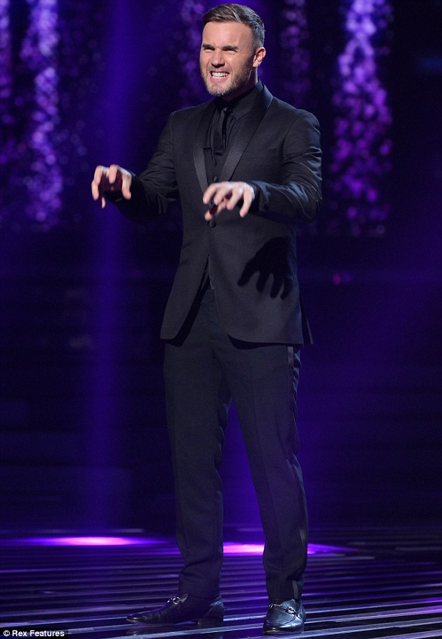 Ghastly: Gary pulls a frightful pose before he takes his seat ahead of the contestants' performances on Saturday night