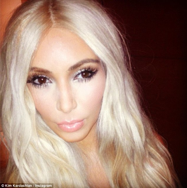 Blonde ambition: Kim also wore a blonde wig for the occasion and shared snaps of her evening on her Twitter and Instagram pages