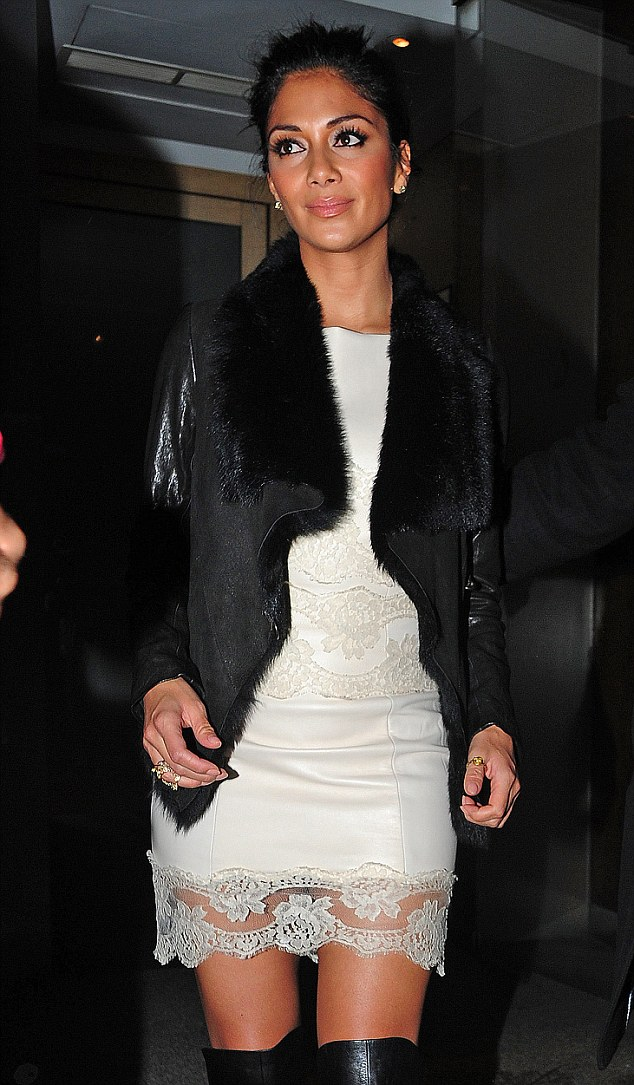 Thigh high: Nicole looked stunning in her white lacy dress, thigh high boots and trendy sheepskin jacket from AllSaints