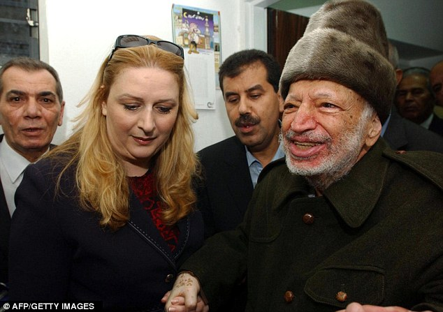Investigation: Yasser Arafat (right) in 2004 with his wife Suha who alleges he was poisoned
